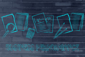measuring performance: business paper folders, stats and budget documents