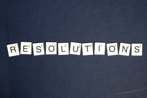 Business resolutions for 2016. Scrabble letters spelling out 'resolutions'