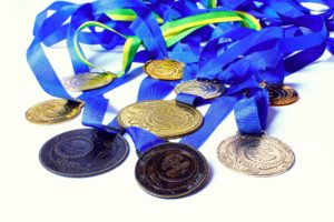 Gold, silver and bronze medals ifor those business owners that achieve their personal best