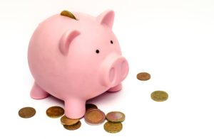Piggy bank image with coins to highlighthow auto-enrolment helps workers to save their money for retirement